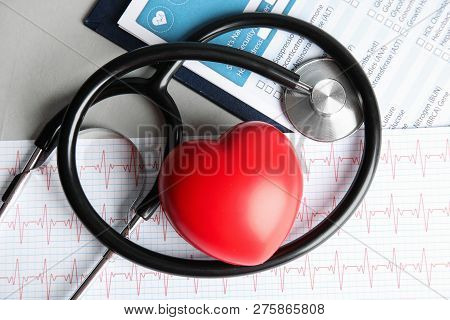 Flat Lay Composition With Red Heart And Stethoscope On Table. Cardiology Concept