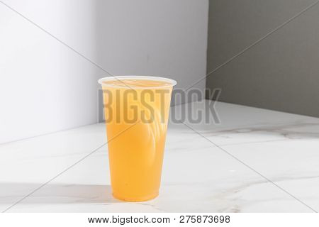 Grapefruit Fruit Tea In A Transparent Glass