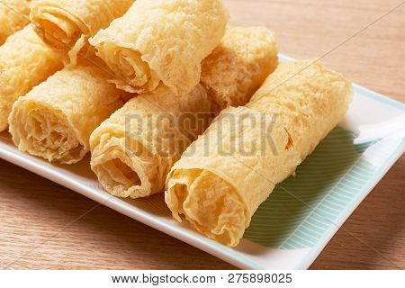 Fried Bean Curd Stick In A White Dish