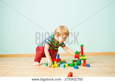 Happy Kid Smashing Toys Tower In The Kindergarten