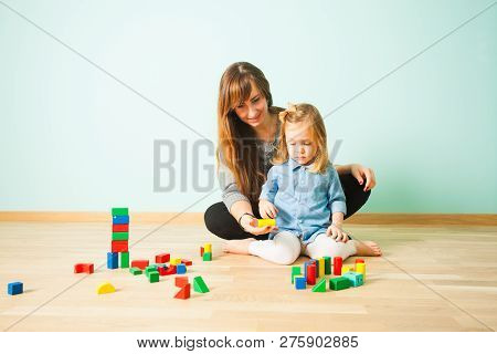 Portrait Of Teacher And Pupil At Preschool