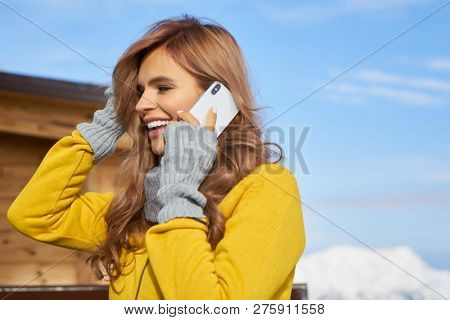 Attractive Young Woman At A Mountain Ski Resort Stock Photo