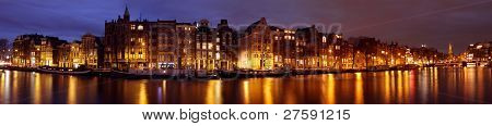 Panoramic city scenic with the Munt Tower at night in Amsterdam the Netherlands