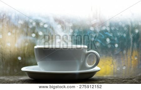Fresh Brewed Coffee In White Cup Or Mug On Windowsill. Wet Glass Window And Cup Of Hot Coffee. Autum
