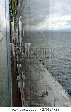 A View Of An Industrial Pier On A Dull, Cloudy Day From A Cruise Ship.