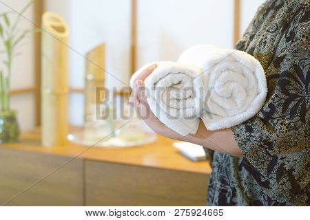 Chambermaid Holding Clean Towels In Spa. Clean White Towel In A Spa Centre. Staff Cleaning Lady Hold