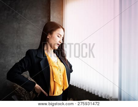 The Tried Woman,unhappy Feeling,standing Beside Window At Office,put Hand Touch Her Back And Tight,b