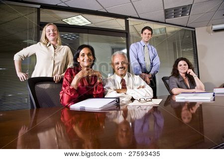 Multi-ethnic group of office workers in boardroom poster
