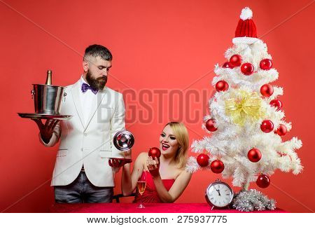 Couple In Love At Christmas Or New Year. Christmas Tree. Couple Before New Year At Romantic Dinner I