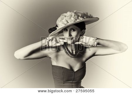 Young srtylish woman with retro hat