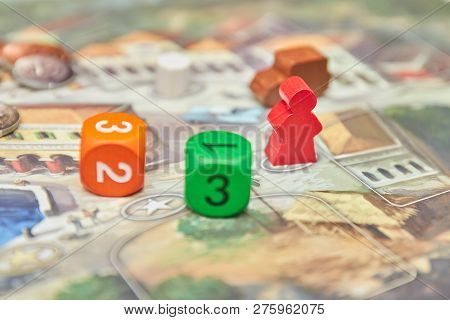 Themed Board Games. Colorful Play Figures With Dice On Board. Vertical View Of The Board Game Close-