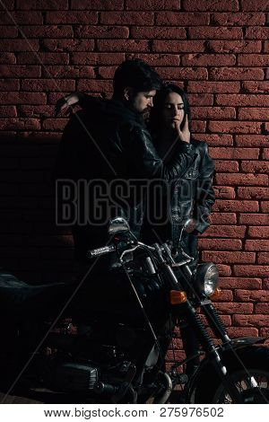 Sexy Couple. Sexy Couple With Motorbike. Sexy Couple On Red Brick Wall Background. Sexy Couple In Lo