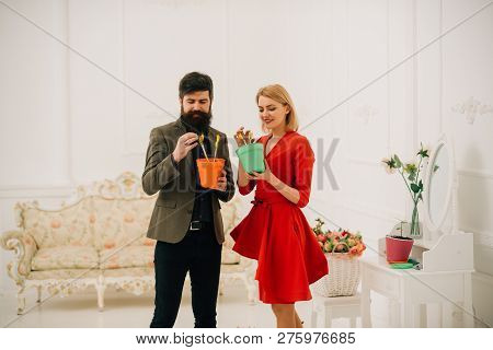 Protection Concept. Bearded Man Help Sensual Woman To Protect Flower. Woman And Man Provide Protecti