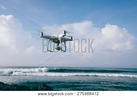 Flying Drone Which Taking Photo Over Sea