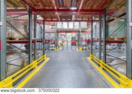 Finished Goods Warehouse, Metal Profile Packed In Bundles. Metal Packages Are On High Storage Racks.
