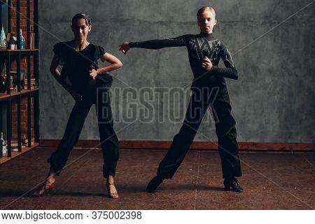 Young Couple Dancing In Ballroom Dance Cha Cha.
