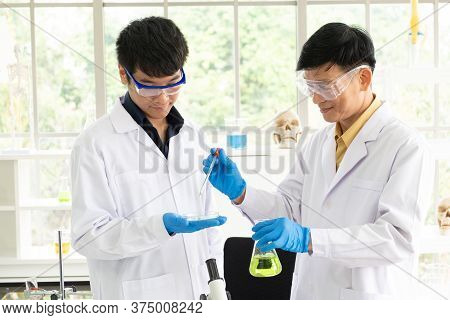 Science, Chemistry, Technology, Biology And Laboratory Concept - Portrait Of Asian Senior And Junior