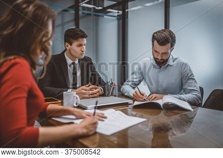 Spouses Writing A Divorce Request With Their Lawyer