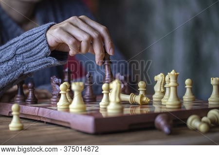 Close Up Shot Hand Of Young Woman Playing Chess For Business Challenge Competition Winner Concept