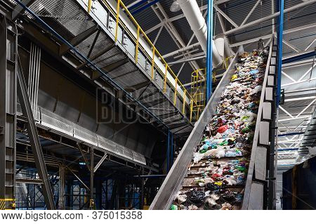 Conveyor Belt With Garbage Transports Waste Inside Drum Filter Or Rotating Cylindrical Sieve With Tr