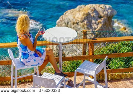 Lifestyle Tourist At Aperitif Drinking A Red Wine Glass And Looking Large Limestone Of Famous Sanson