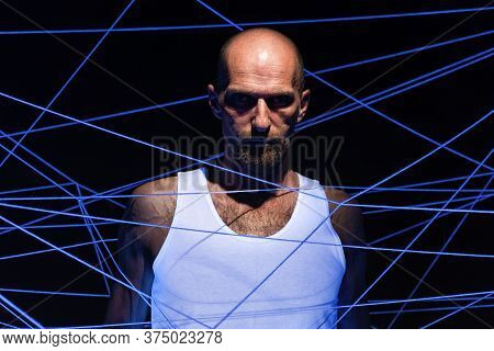 Adult Man Tangled In White Rope In Ultraviolet