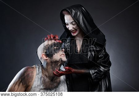 Mad Man And Scary Woman With Blood Hands