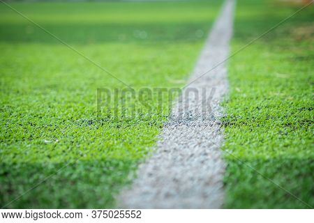 White Stripe Line On Green Grass For Sport Soccer Field With Nobody For Background