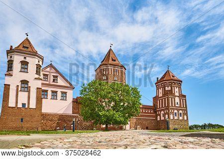 Mir, Belarus - June 12, 2020: Mir Castle Complex In Summer Day With Blue Cloudy Sky. Tourism Landmar