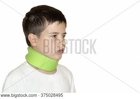 A Boy In An Orthopedic Corset Around Neck. Spinal Injury In A Child. Treatment Of Cervical Osteochon