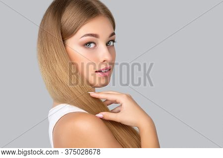 Beautiful Young Blonde With Clean Fresh Skin And Beautiful Makeup, Long Healthy Shiny Blond Hair. Sh