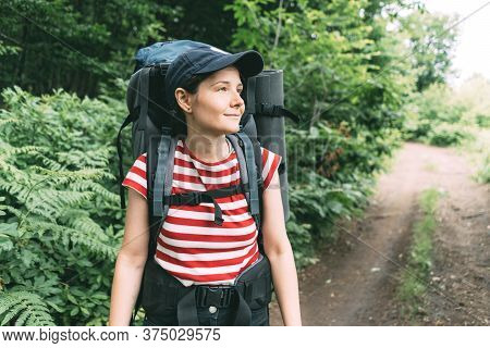 Local Travel In Nature Reserves. Young Pretty Woman With A Big Hiking Backpack On A Hiking Trail. Su