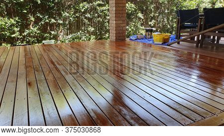 Australian spotted gum deck being stained for the first time