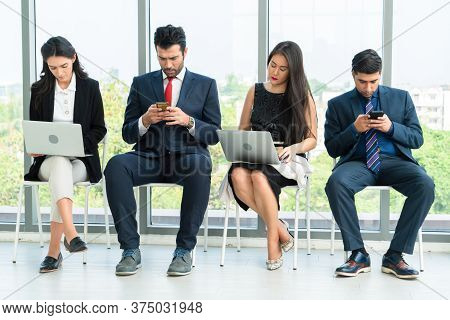Job Seekers And Applicants Waiting For Interview On Chairs In Office. Job Application And Recruitmen