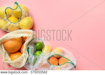 Citrics, Lime, Lemon, Orange In Reusable Eco Friendly Mesh Bags On Pink Background. Zero Waste Shopp