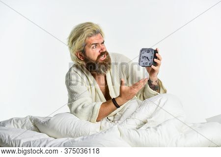Sleep Disorder. Sleepy Guy And Alarm Clock In Bed. Healthy Habits And Lifestyle. Bearded Man With Al