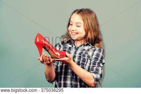 I Love It. Small Girl With Stylish Shoes. Happy Child Hold Fashionable Shoe. High Heel Lover. Shoes