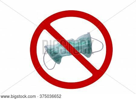 Used Green Surgical Face Mask In Red Forbidden Symbol On White Background. No Discard Used Medical F