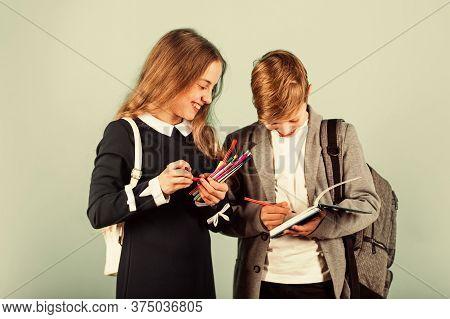 Before Examination. Small Children Prepare For Examination. Little Girl And Boy Hold Examination Pap