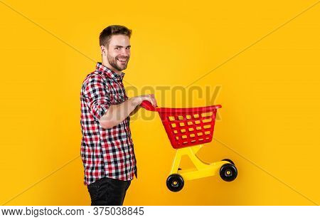 Funny Man With Small Shopping Cart. Weekend On Buying Products. Rejoices Successful Purchases. Spend