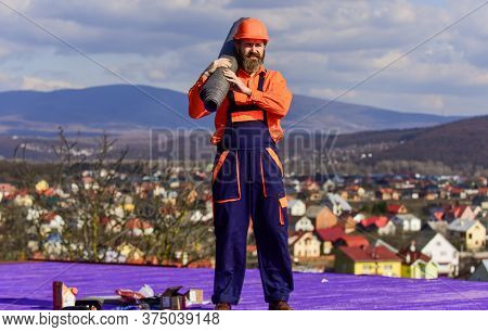 Man For Any Job. Flat Roof Installation. Roofer Worker In Special Protective Work Wear. New Roof Und