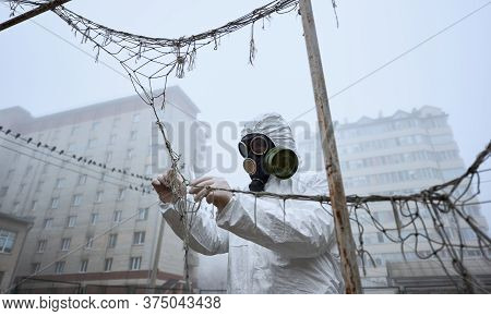 Environmentalist Holding Tweezers And Test Tube While Taking Samples On Abandoned Foggy Street. Ecol