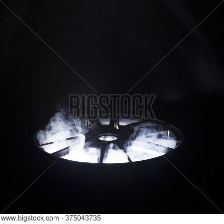 A Modern Beautiful Automotive Alloy Wheel In The Form Of Rays That Is Highlighted By Rays Of Light A
