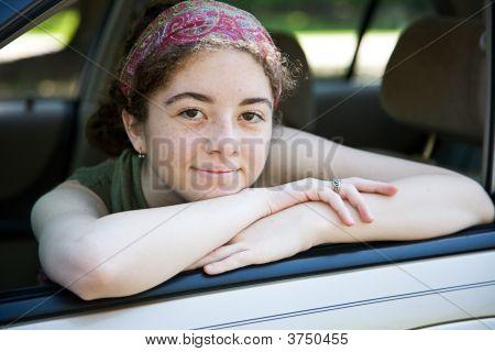 Teen In Car Window