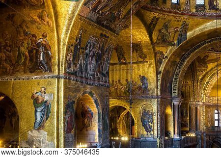Venice, Italy - May 21, 2017: Golden Wall Mosaic Inside San Marco Or St Mark`s Basilica, It Is Old L