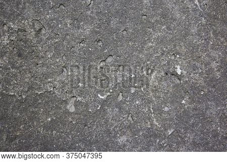 Muddy Concrete Wall With Cracks And Black Spots. Old And Dirty Tested Wall Background. Architecture
