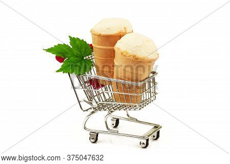 Tasty Milky Ice Cream In Waffle With Fresh Green Leaf In Metallic Shopping Trolley Isolated On White