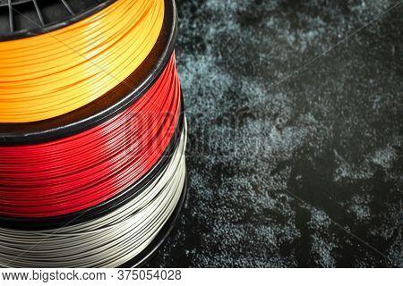Filament For 3d Printing. Bright Thermoplastic Of Neon Orange, Color. Reel Horizontal View. Macro