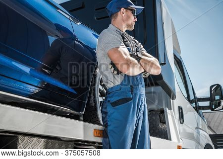 Repo Man In Front Of His Truck. Car Loan Problems And Vehicle Repossession Theme. Vehicle Financing
