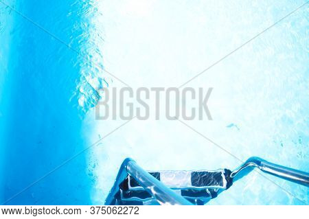 Blue Ripped Water In Swimming Pool. Clear And Blue, Clear Water In The Pool. Surface Of Blue Swimmin